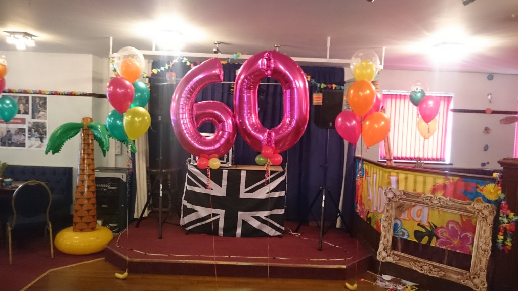 60th Birthday Party At The Coombe Social Club Tropical Hawaiian Theme Bouquets Numbers And Fresh Fruit Weights